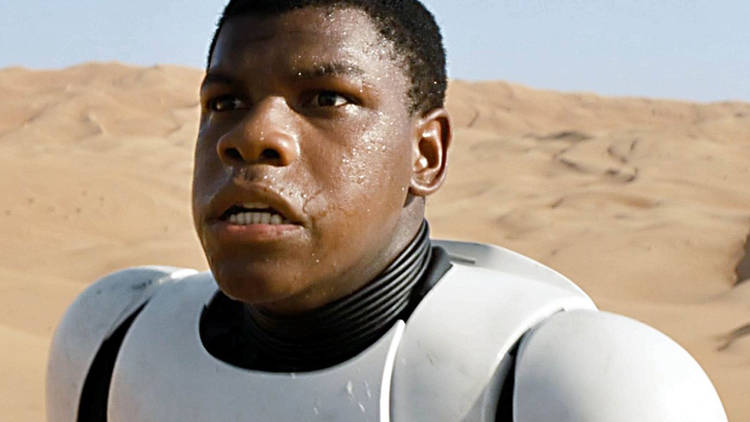 Actor John Boyega playing a stormtrooper in Star Wars: The Force Awakens