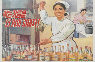 "North Korean propaganda poster reads, ""Squeeze out more edible oil!"""