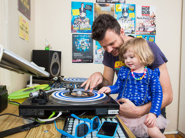 Tom Loud (Hot Dub Time Machine) and his daughter Lizzie with a turntable