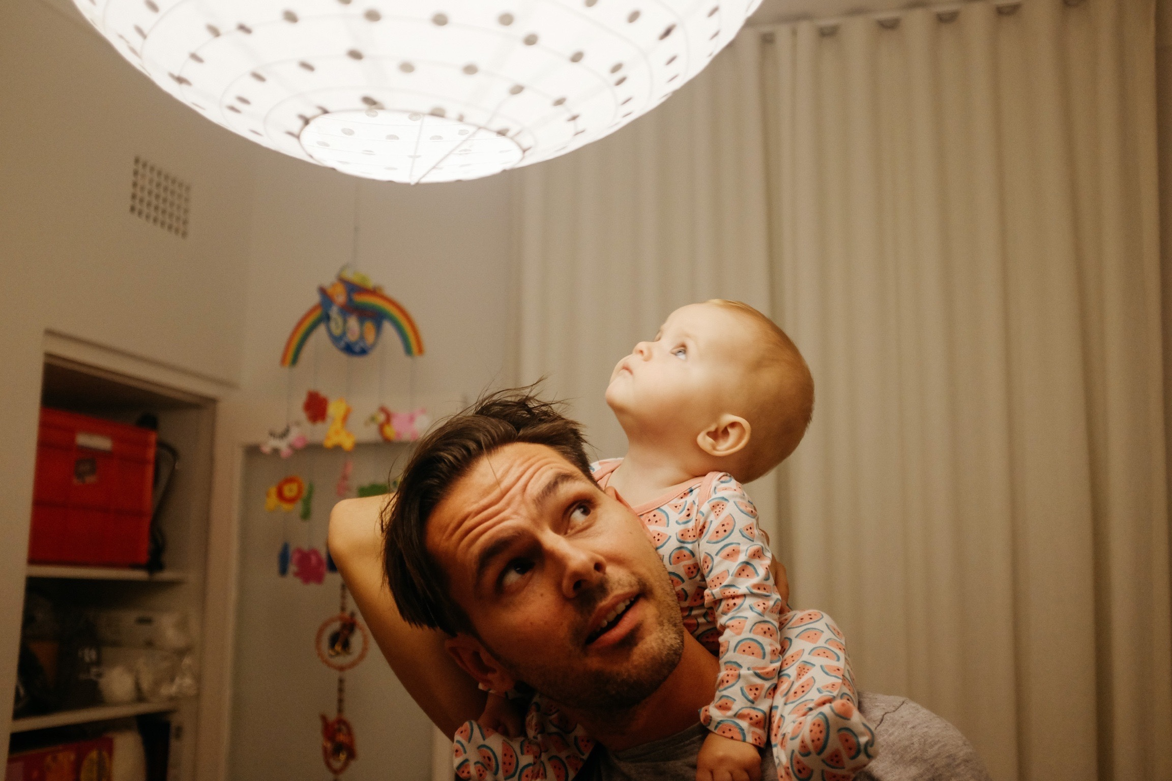 Daniel Boud and his Daughter Lilya under a lamp