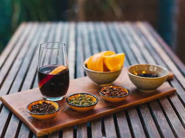 Mulled wine platter on a wooden table at Vegie Bar