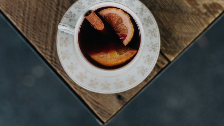 Top down view of mulled wine on a wooden table at Milk the Cow