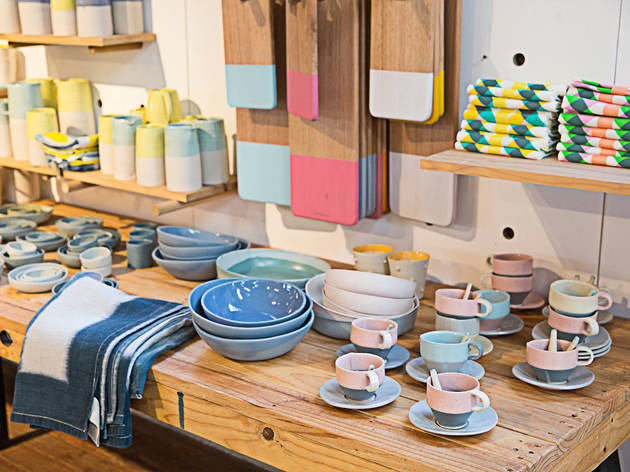 Colourful ceramics stacked up on a wooden display