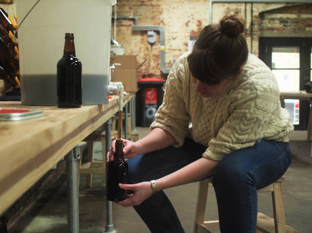 filling bottles at Brew Club, Clapton