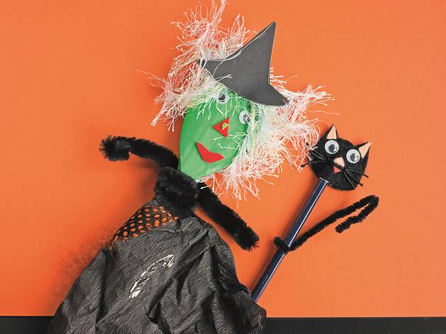 Handmade witch with orange background