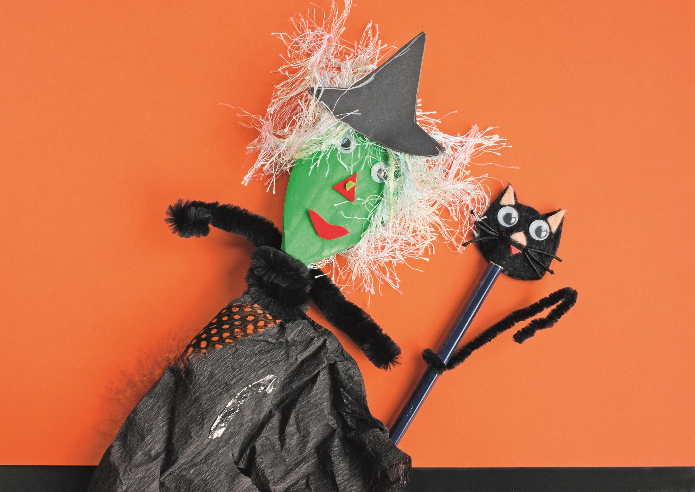 Handmade witch with orange background