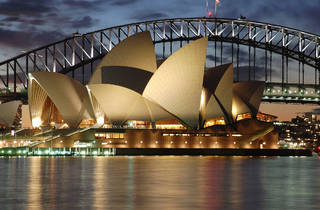 The Opera House at twilight, with the harbour bridge behind it.