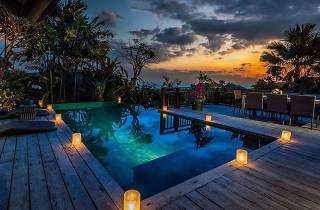 A candlelit pool at Karma Kandara resort in Ungasan, Bali