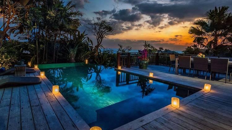 A candlelit pool at Karma Kandara resort in Ungasan, Bali