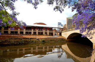Riverside Theatres 2007 exterior shot 01 with jacaranda trees and waterways courtesy Riverside Theatres 2016