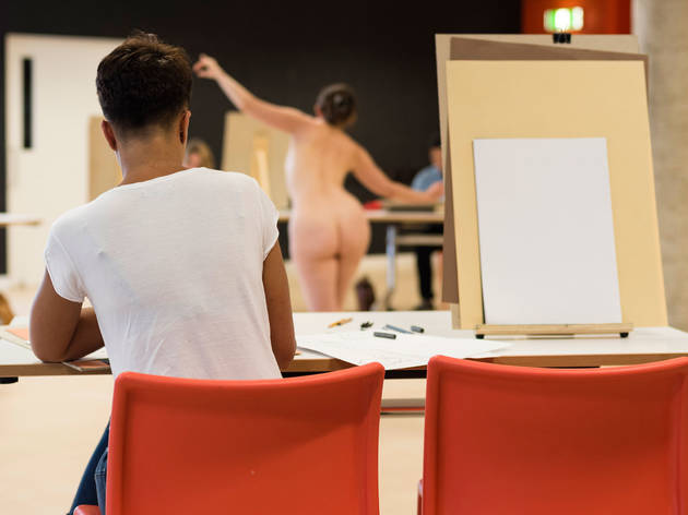 In the foreground, a person drawing; in the background a nude person who is being drawn.