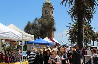 Shoppers browse stalls at the The Esplanade Market in St Kilda