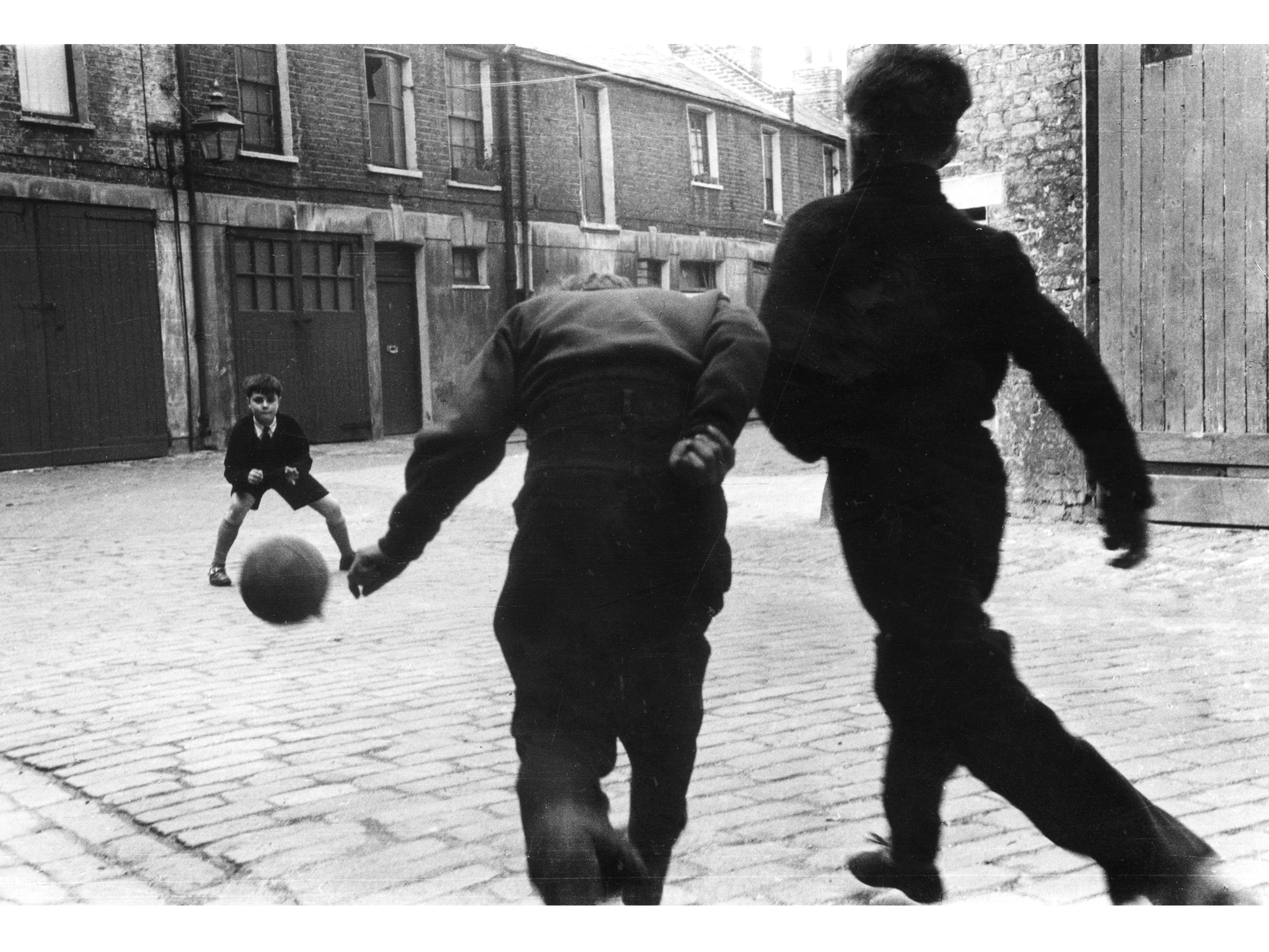 Best London photos: Roger Mayne: Football, Addison Place, North Kensington, 1956. © Roger Mayne/Mary Evans Picture Library