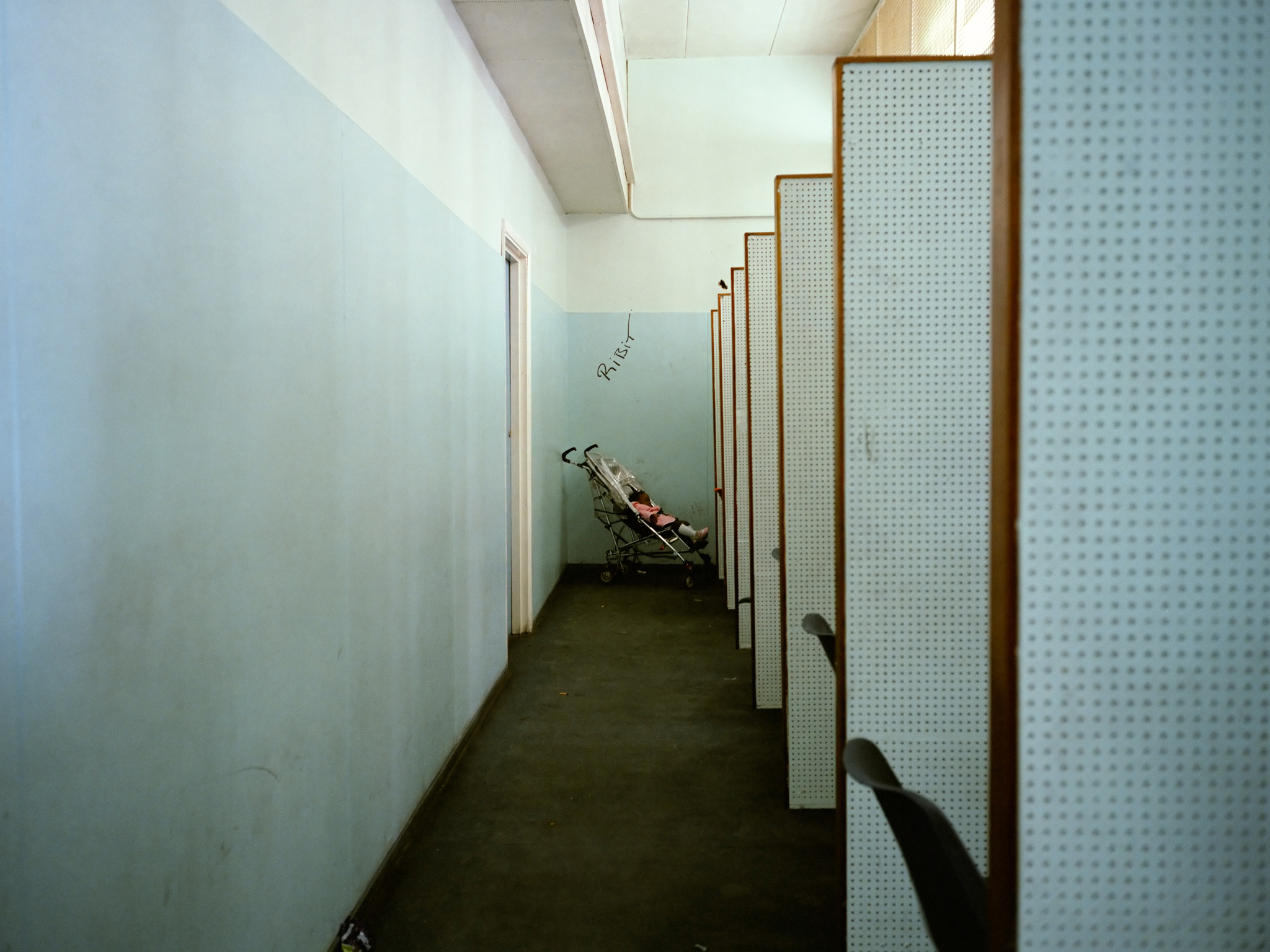 Best London photos: Paul Graham: Baby and Interview Cubicles, Brixton DHSS, South London, from the series Beyond Caring, 1984. © Paul Graham