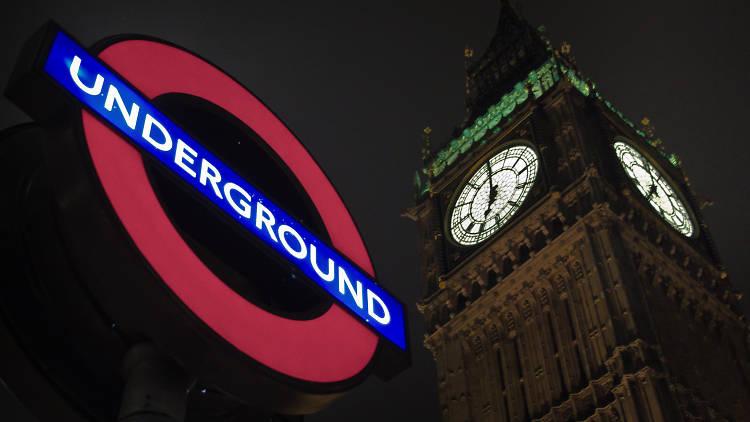 London Underground sign at night