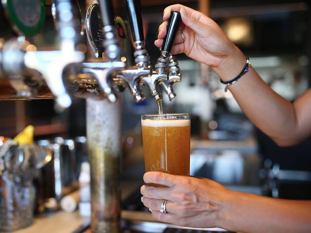 Staff pouring beer at Up in Smoke