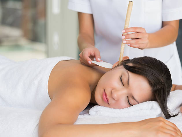 Ear candling treatments at spas and salons in New York