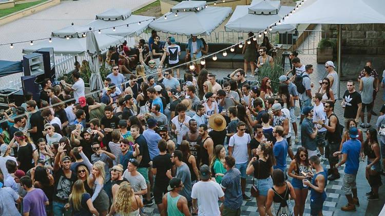The Sash crowd dances on the outdoor dancefloor at Sydney's Greenwood Hotel