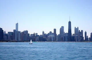 Chicago skyline from lake with boat