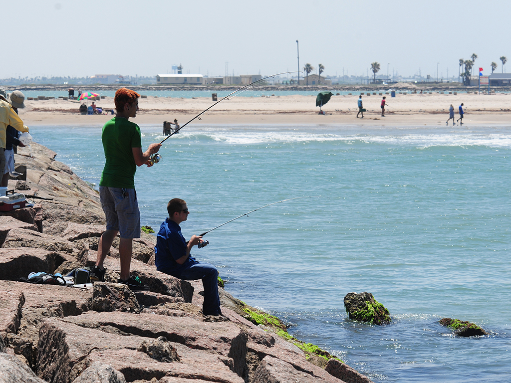 People on breakwater at Isla Blanca Park, South Padre Island, Te
