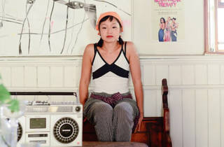 Dancer sat on a bench with a boombox on a table