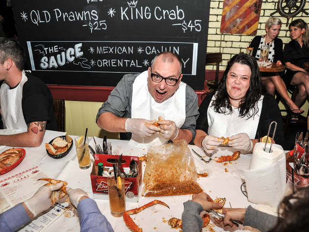 People sat at a table eating crab