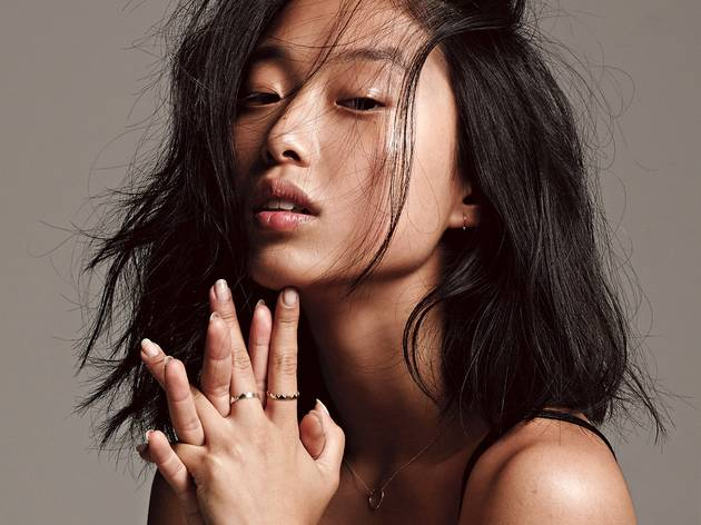 A self-portrait of Margaret Zhang with hair across her face