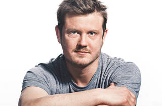 Screenwriter Beau Willimon looks at camera with closed arms