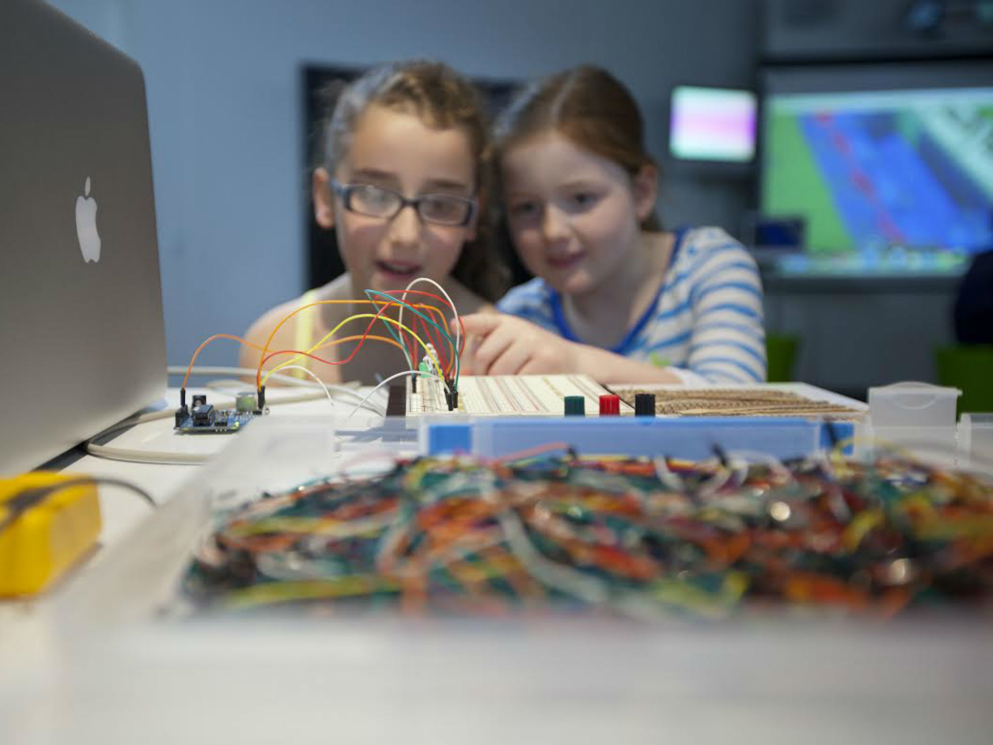 Two young girls working with electronics at the powerhouse museum