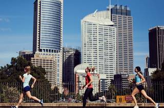 Three women running in the city