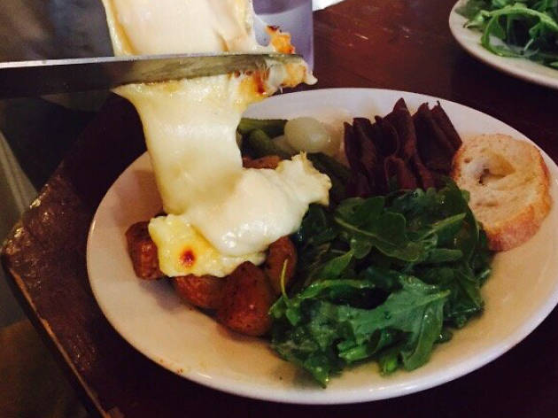 Dig into a face-melting dinner at Raclette
