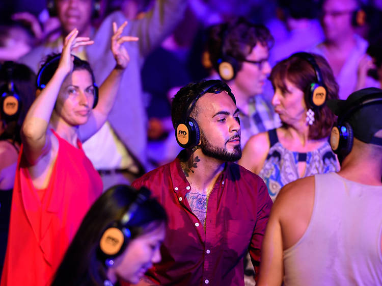 Party in headphones at a silent disco