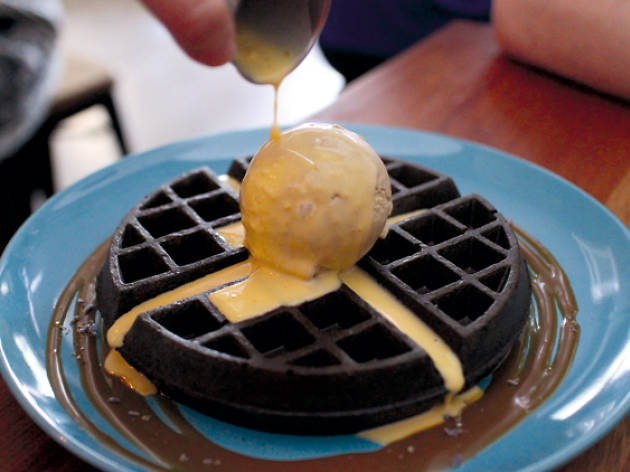 Gourmet waffles with salted egg yolk sauce