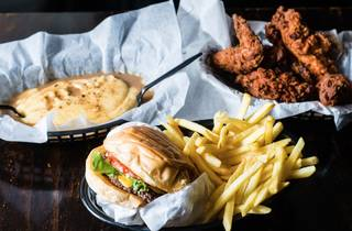 Burger, fries, fried chicken and mashed potato and gravy at Mary