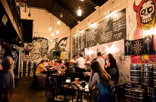 An interior shot at Mary's showing people sitting at tables drin