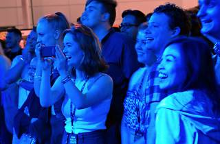People recording and laughing at a performance