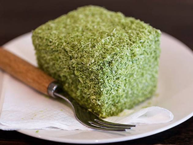 Matcha lamington on a small plate with a fork
