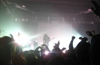 Ratatat performing on stage, people in the crowd cheering
