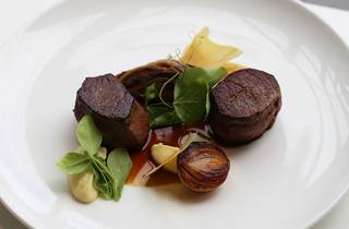 Beef fillet with charred onion, shallot puree and jus at Meat Fish Wine