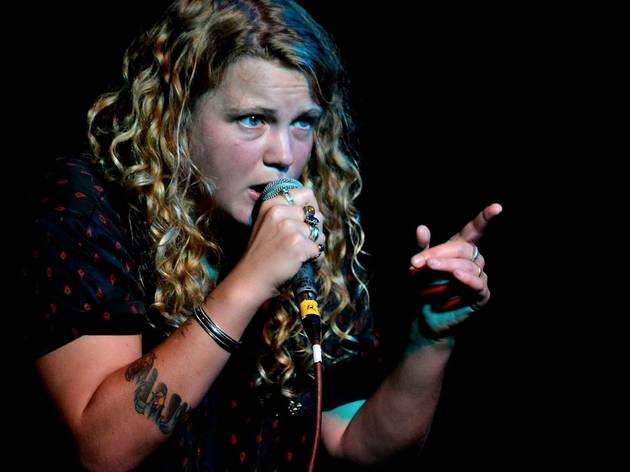 Kate Tempest performing on stage