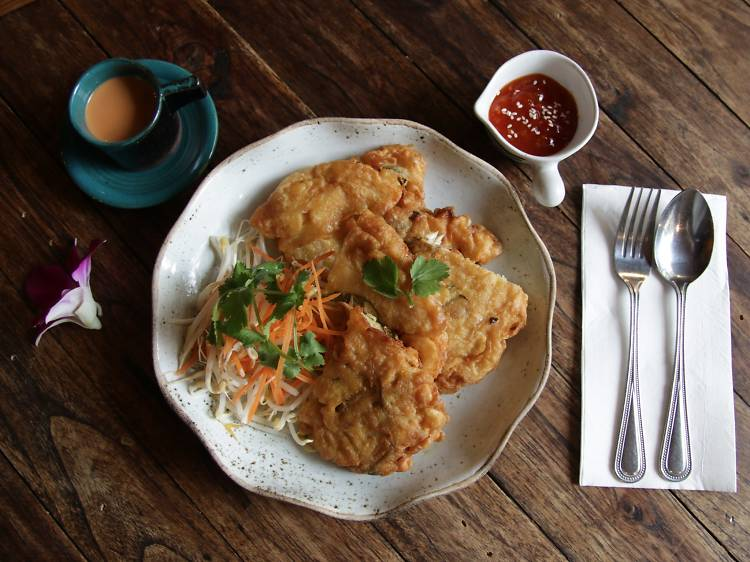 Crispy mussel omelette with Sriracha sauce and bean shoots