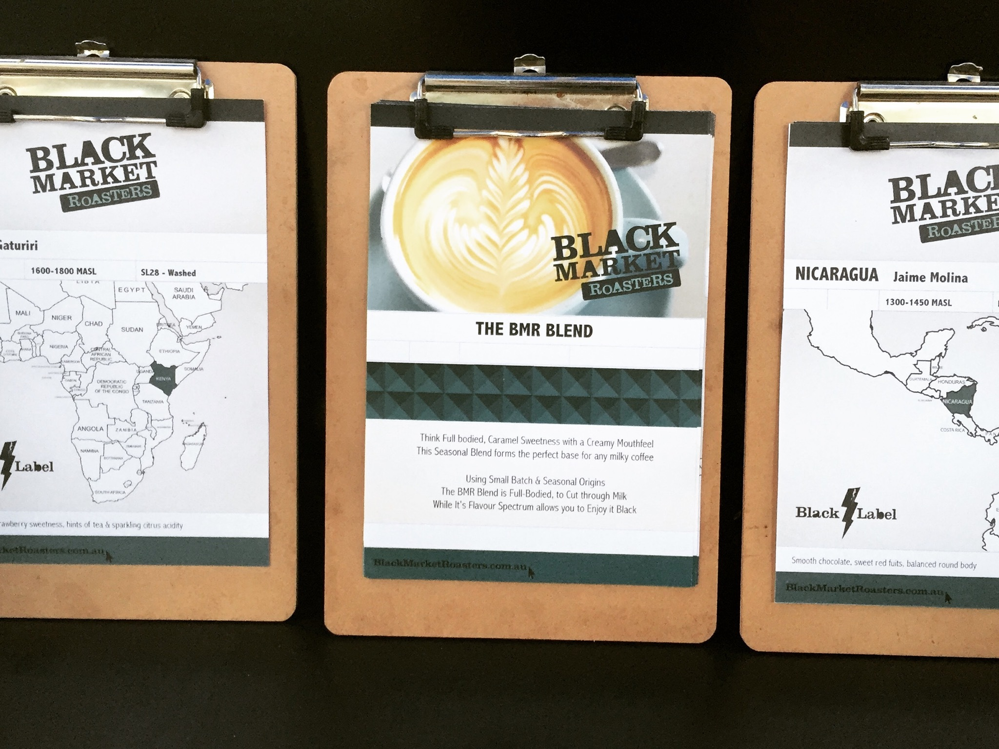 information about coffee on clipboards