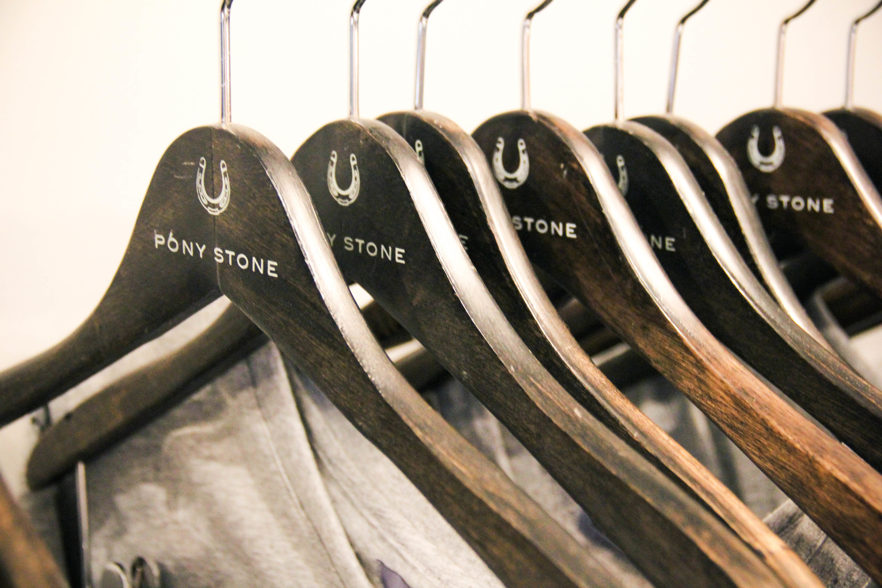 a rack of clothes at pony stone