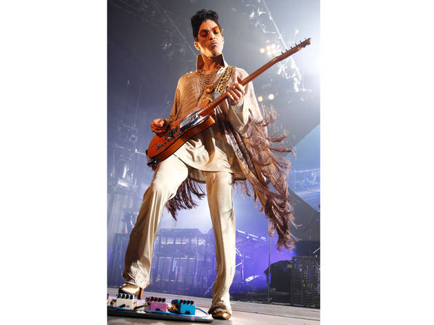 2011, Rotterdam, Netherlands. Beige snakeskin fringed poncho with a sci-fi collar for his Welcome 2 Europe tour.