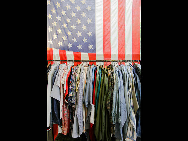 a rack of clothes at What's Vintage