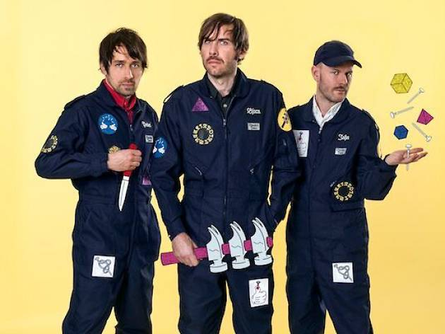 swedish trio peter, bjorn and john standing in line with workers jumpsuits on holding animated tools