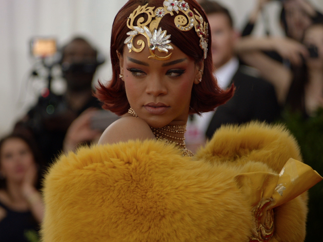 Rihanna wears a fluffy yellow robe at the Met Gala in 2015