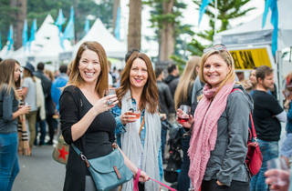 Three women drinking wine at Taste of Manly