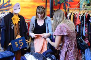 Two women shopping at a vintage sale