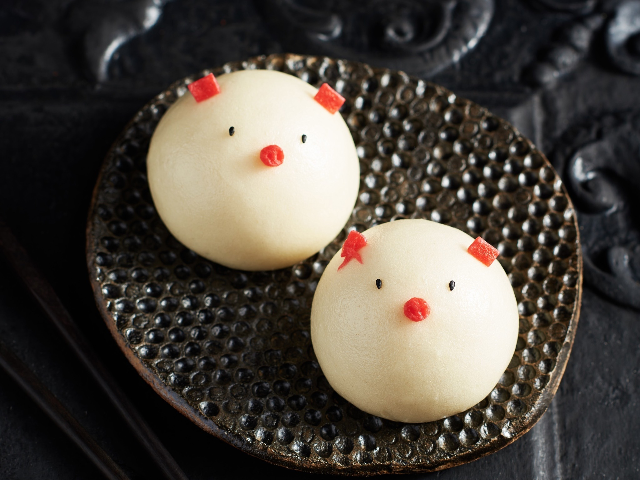 Two dumplings made to look like pigs